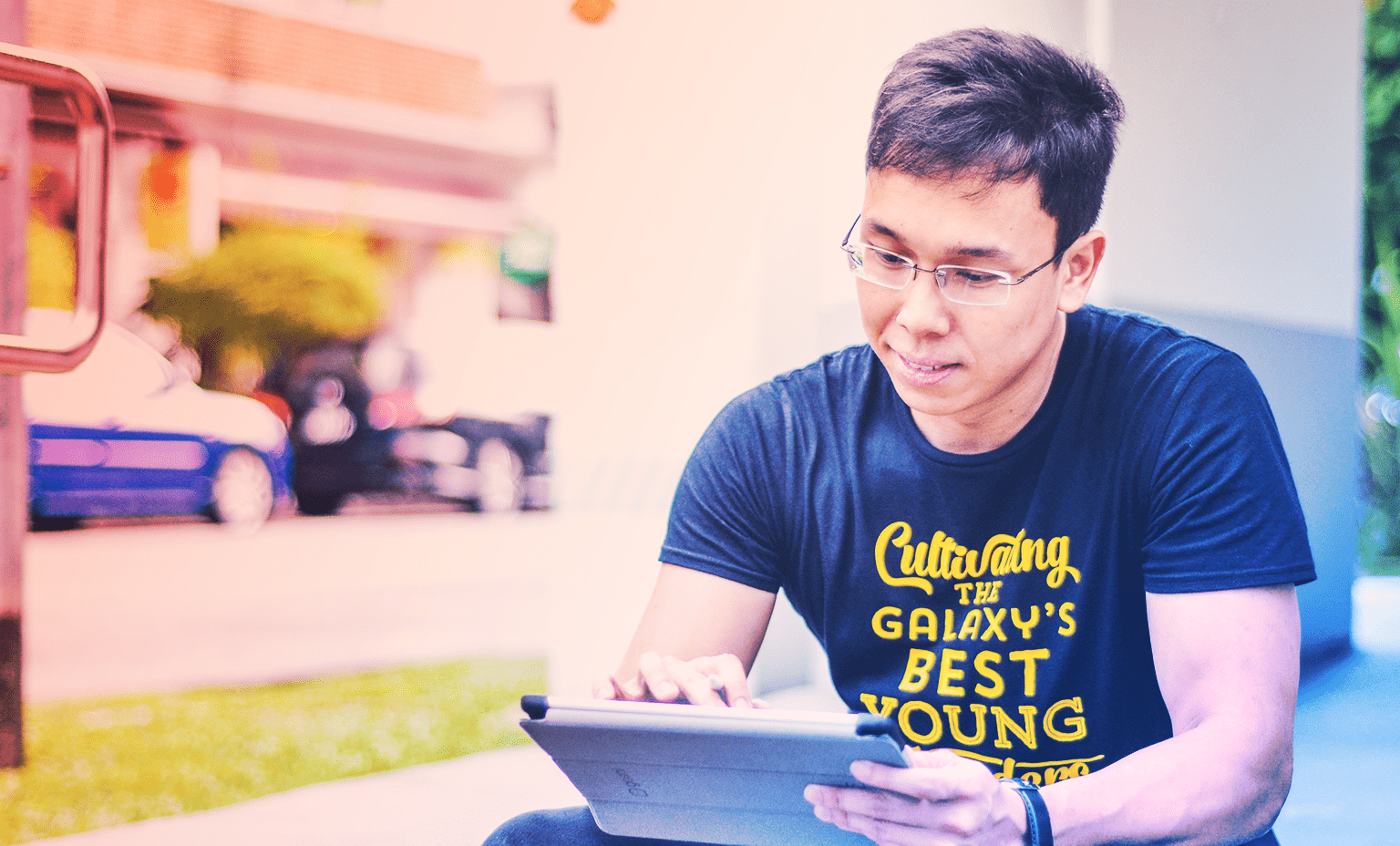Surviving a Startup Environment: Mentoring aspiring changemakers - Khairul Rusydi on his tablet