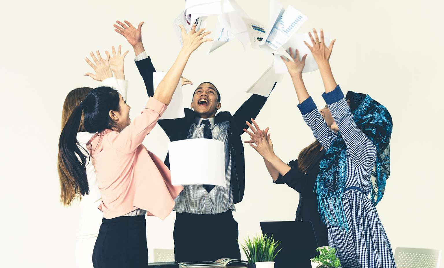 What Millennials Want - happy employees at work
